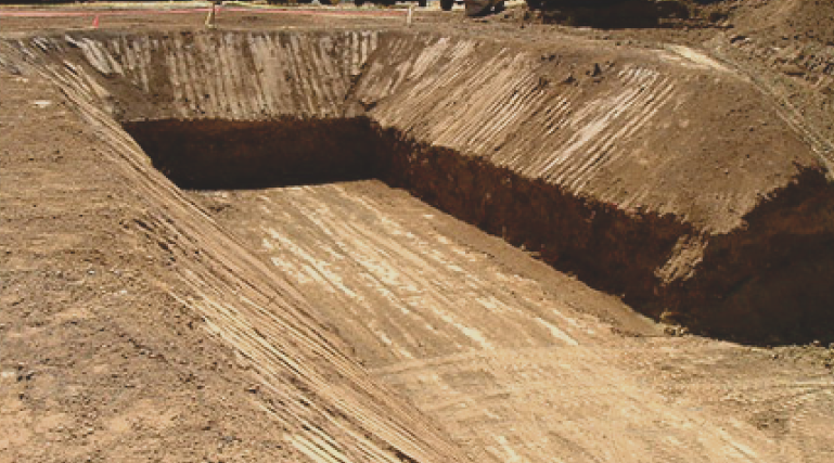 digging-a-hole-in-the-ground-on-a-site-for-a-foundation-and-basement-of-residential-home